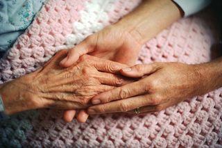 Hands younger holding older
