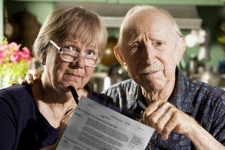 Elder-Couple-looking worried