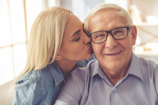 Daughter kissing dad on cheek