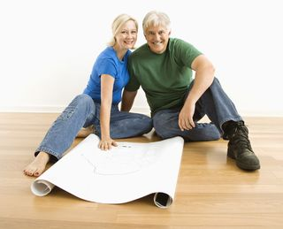 Architectural plans viewed by couple