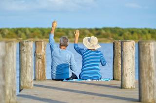 Elders sitting on a dock