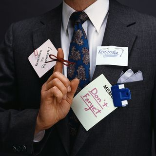 Man with notes to remember to remember