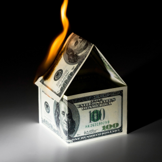 Burning house made from money