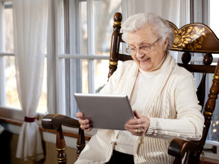 Tablet senior woman using