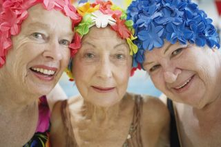 Older women in swim caps