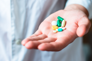 Hand holding medicines