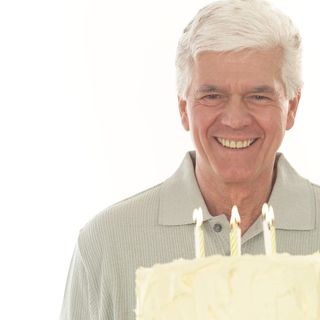 Baby boomer age in front of birthday cake